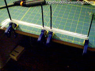 A simple jig for making string heddles.